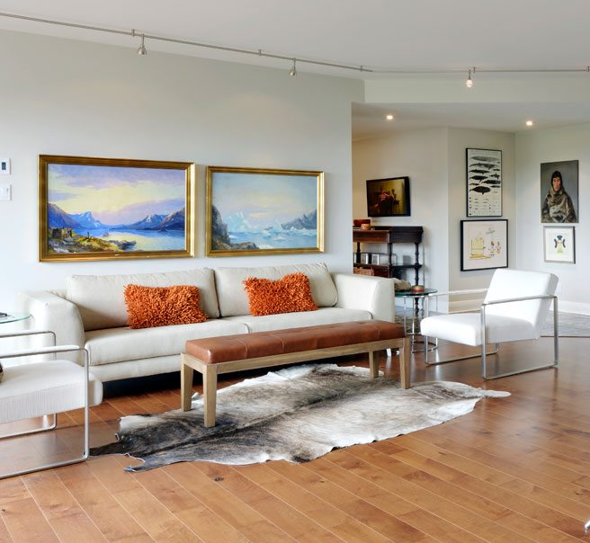 Langlois sourced the couch and side chairs from the Laval outlet of BoConcept, a Denmark-based company that has been designing and manufacturing furniture for almost 60 years. The two landscape paintings above the couch are by Einar Throbjorn, and depict the south-west coast of Greenland, where the couple has travelled extensively.