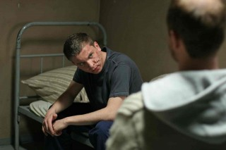 The main character, Ben, shown in his prison cell.