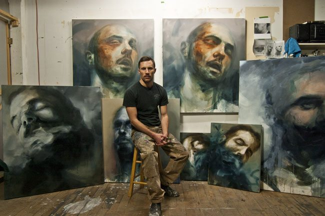 Andrew Moncrief, sitting with some of the works featured in his show at La Petite Mort Gallery, DE/GENERATE