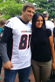 REDBLACKS fullback Patrick Lavoie poses for a pep rally photo with a fan. July 17, 2014