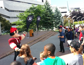 REDBLACKS mascot Big Joe lip-synchs to a Shania Twain song at the July 17th pep rally