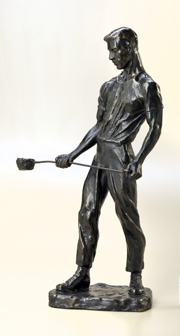 This worker stands ready to pour molten iron into a mould. Wartime shells and domestic tools — as well as this bronze statue — were made in moulds. By emphasizing the figure's powerful stance, Canadian sculptor Florence Wyle captures the strength required to do this kind of work. Notice the way the ladle bends under the weight of the liquefied iron. A Moulder Sculpted by Florence Wyle between 1918 and 1919 Beaverbrook Collection of War Art Canadian War Museum 19710261-0424