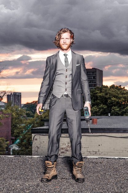 Matt is wearing a Z Zegna suit and tie, a Hugo Boss shirt, a vest by Diesel, and Terra Lite work boots. Photo by Andrew Carson