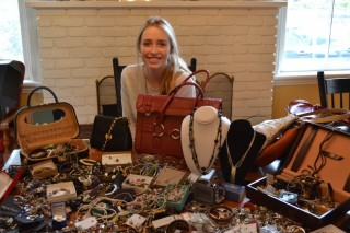 Eva von Jagow shows a sample of jewellery one can buy at her fundraiser