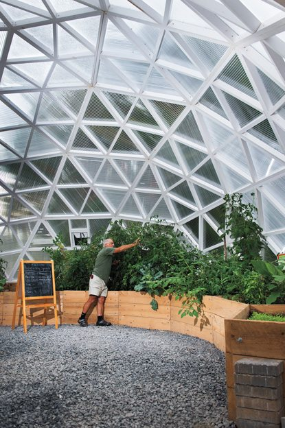 Volunteer Marcel Bélanger tends the gardens in the biodome, which is located in Old Ottawa South. Photo by Luther Caverly.