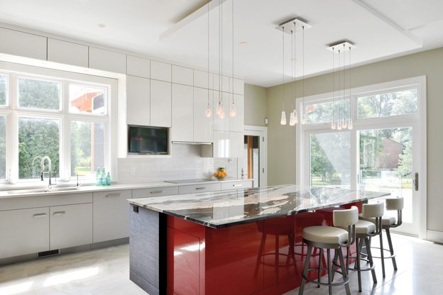 GREAT SPACE: A sleek family kitchen celebrates clean design — with a splash of colour