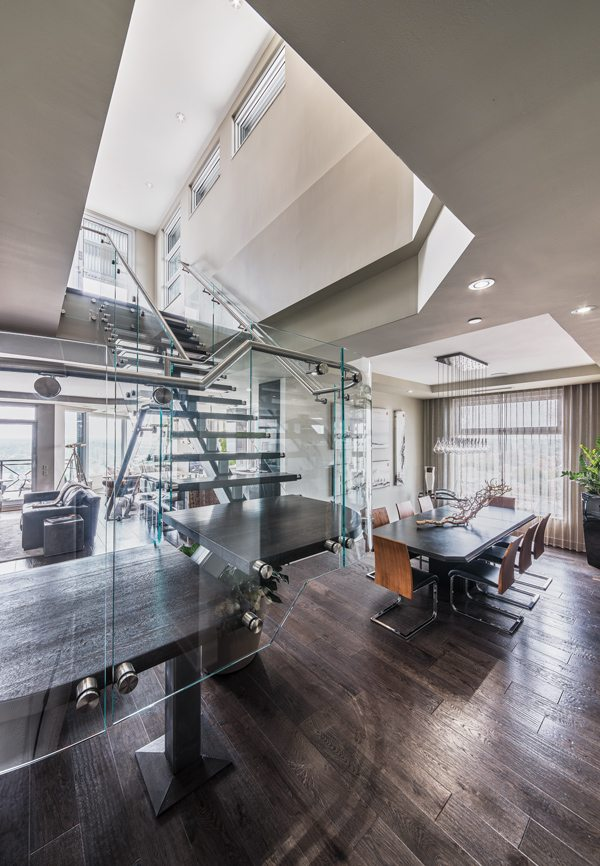 2H Interior Design Ottawa Website. Designed by Ernst Hupel, the steel and  glass floating staircase makes a bold statement.