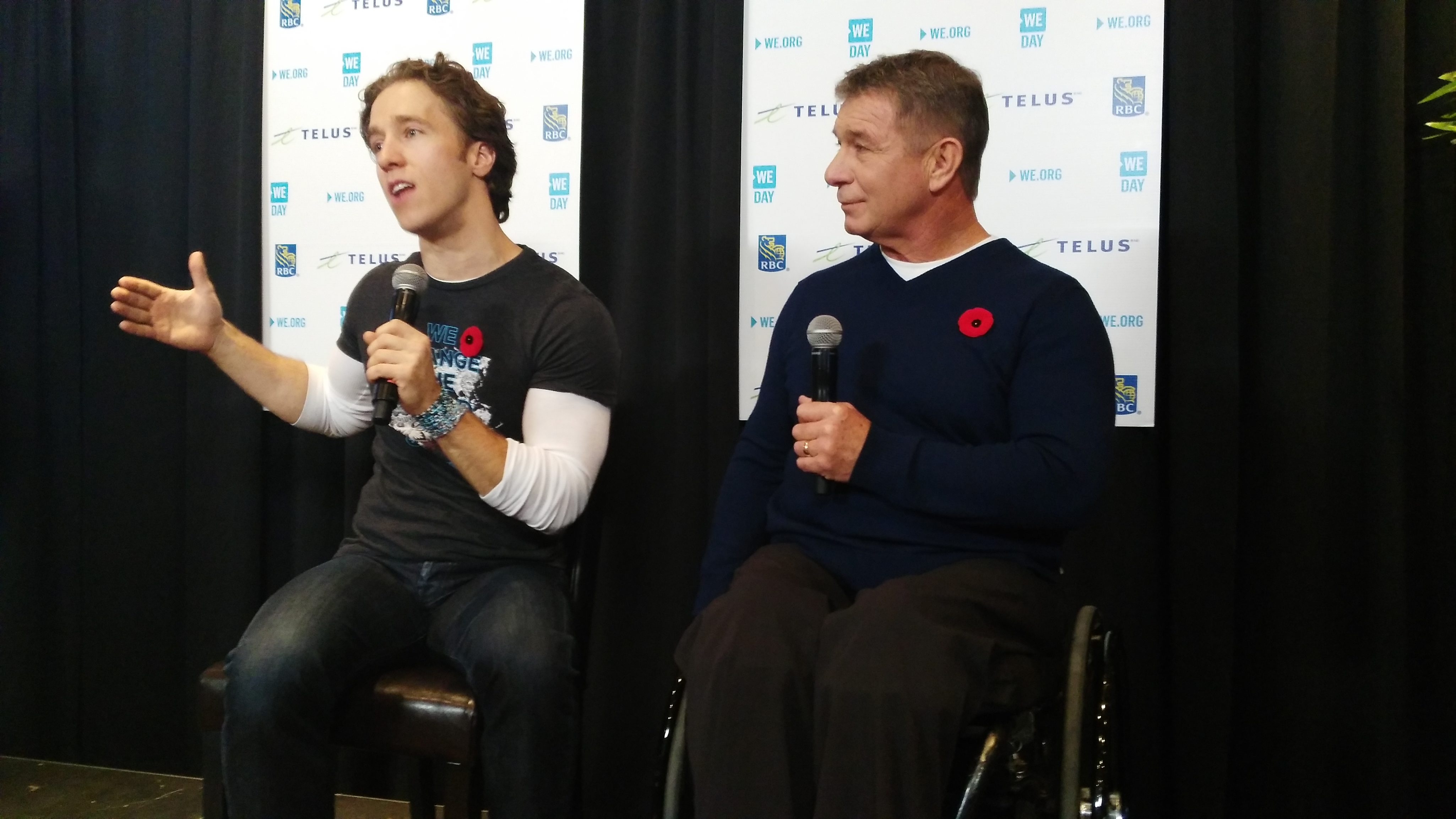 WE Day co-founder Craig Kielburger and Canadian Paralympian, activist and philanthropist Rick Hansen address members of the media at the Canadian Tire Centre. Photo by Nicolina Leone, Ottawa Magazine.