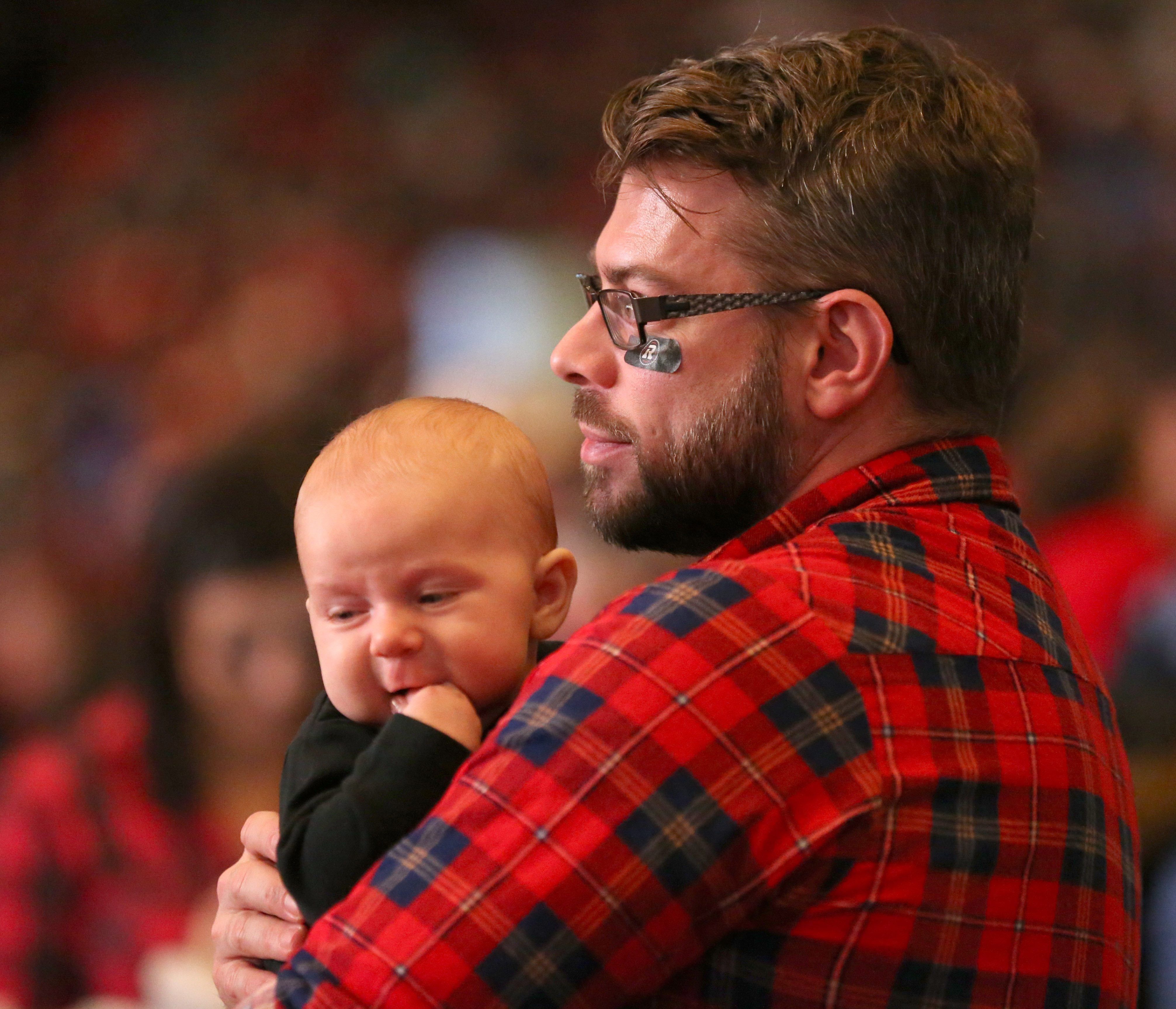 Mike Rafter and his son Milo, three months, watch the game. Photo by Jana Chytilova, OTTAWA magazine.