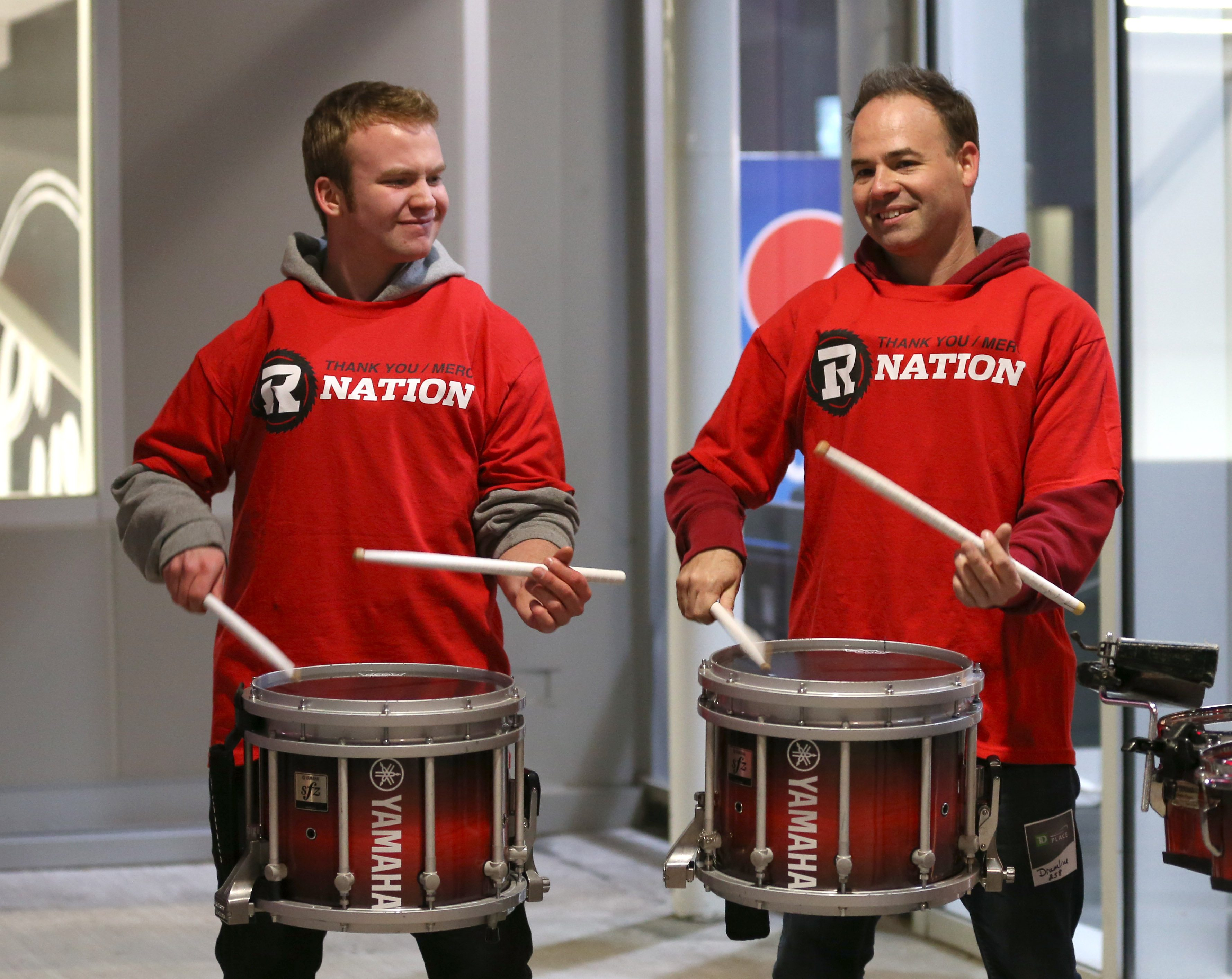 A drumline plays prior to the start of the 103rd Grey Cup game between the Edmonton Eskimos and the Ottawa Redblacks at a viewing party at The Arena at TD Place. Photo by Jana Chytilova, OTTAWA magazine.