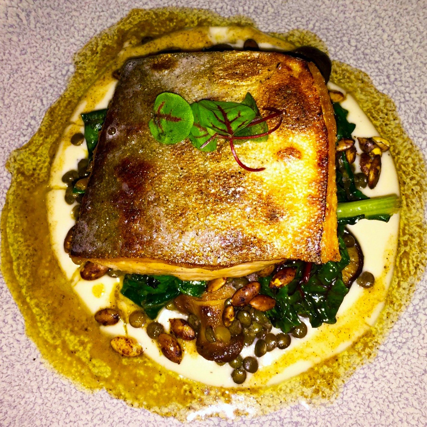 Arctic char came propped up on a hash of lentils, roasted sunchokes, shiitakes and chard, set in a sunchoke puree and ringed with a brown butter-enriched vinaigrette. Photo: Anne DesBrisay