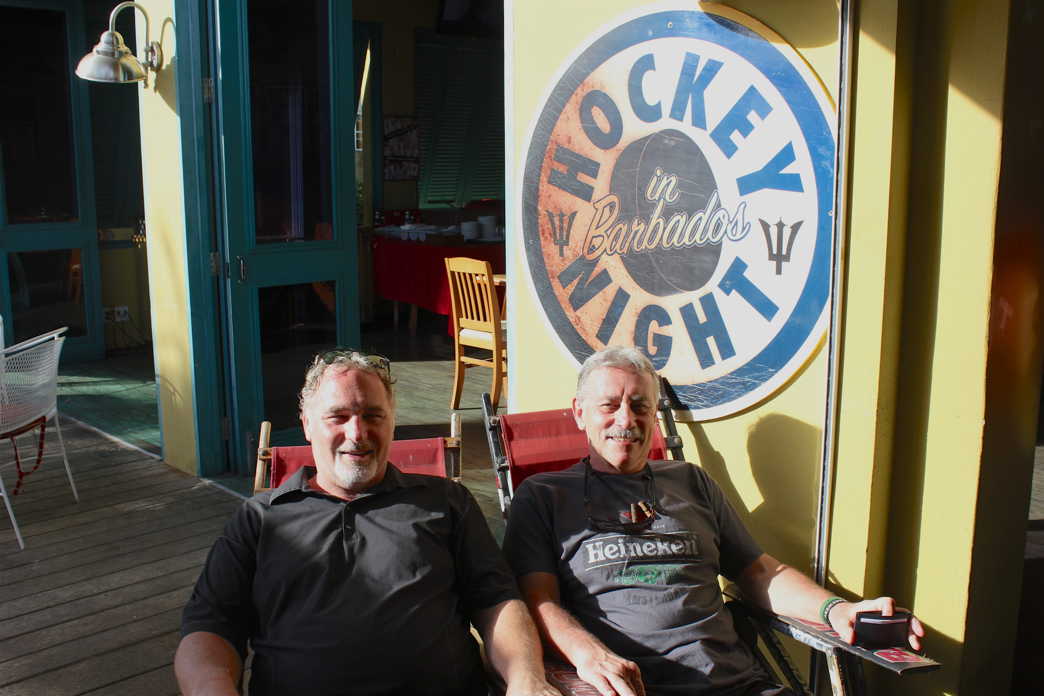 Winchester Travel Agents and Hockey Week organizers Al Armstrong, left, and Owen Shortt. Photo by Kimberley Johnson, Ottawa Magazine.