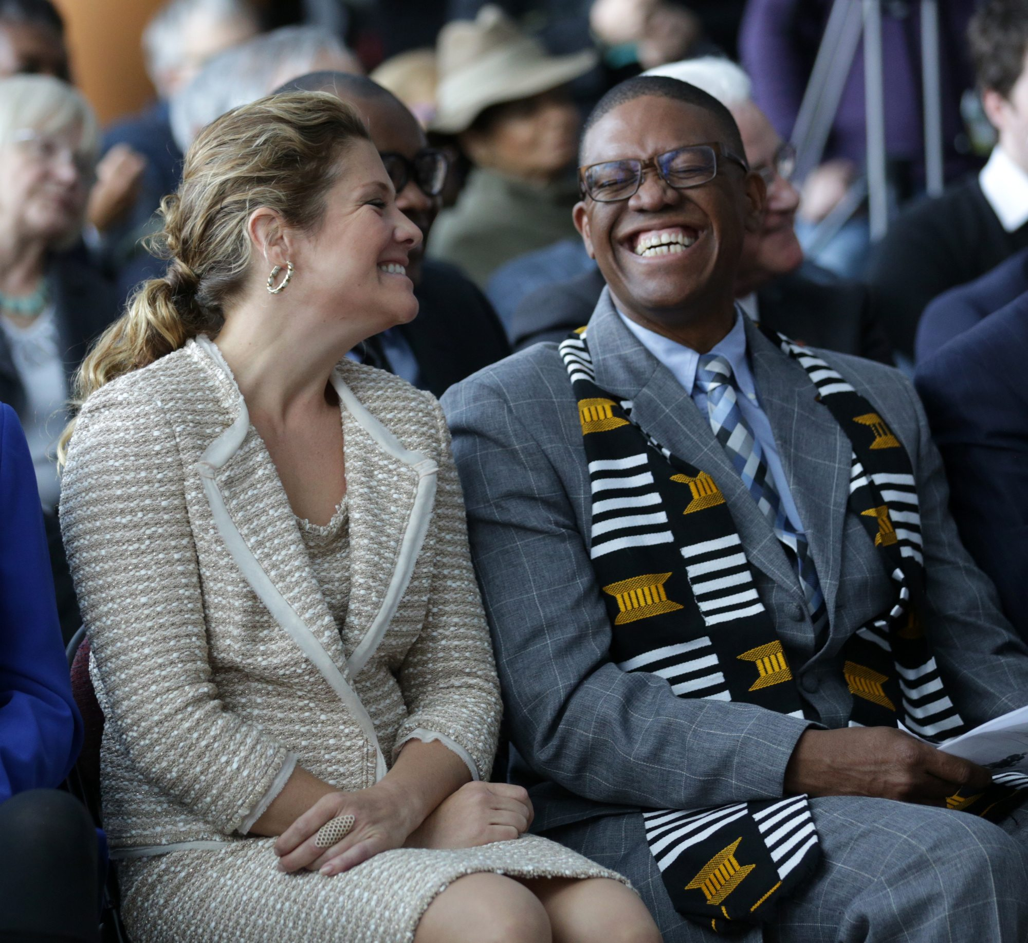 Rev. Anthony Bailey shares a laugh with Sophie GrŽégoire-Trudeau. Photo by Mike Carroccetto, Ottawa Magazine.