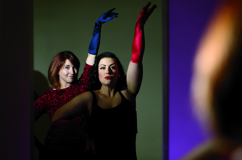 Writer Diane Golding (left) gets a lesson in burlesque from Kitty Kinevil at the McNabb Recreation Centre in Ottawa Tuesday, December 8, 2015. Lessons at the Ottawa Burlesque Academy will start January 7th and will run every Thursday night at the centre in the new year. Photo by Julie Oliver
