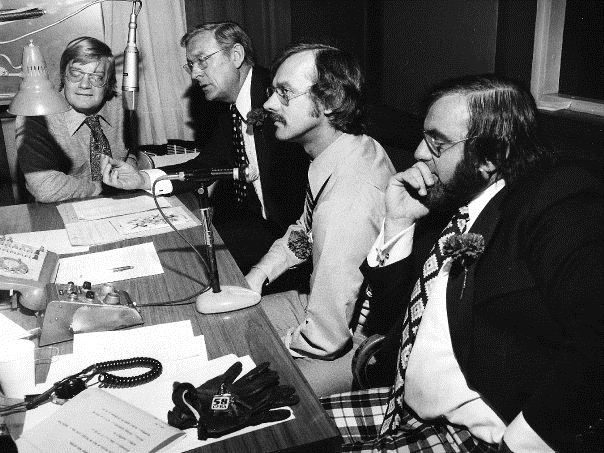 An archival photo from CFRA's website shows Lowell Green at the mic with Terry Kielty, Joel Thompson and Ken Grant.