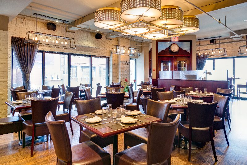 The Luxe look: lots of brown, leather, and big collegial booths at the back. Luxe nails the classic steakhouse ambiance.