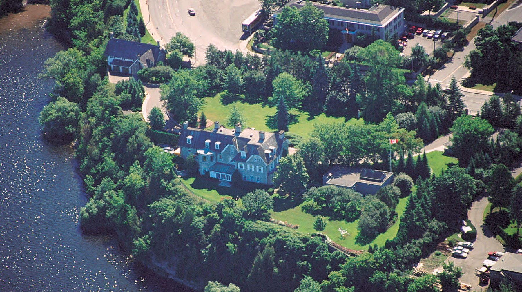 A bird's-eye view of 24 Sussex, showing its proximity to the river. Garage and security installation are visible on right. Photography courtesy of the National Capital Commisison