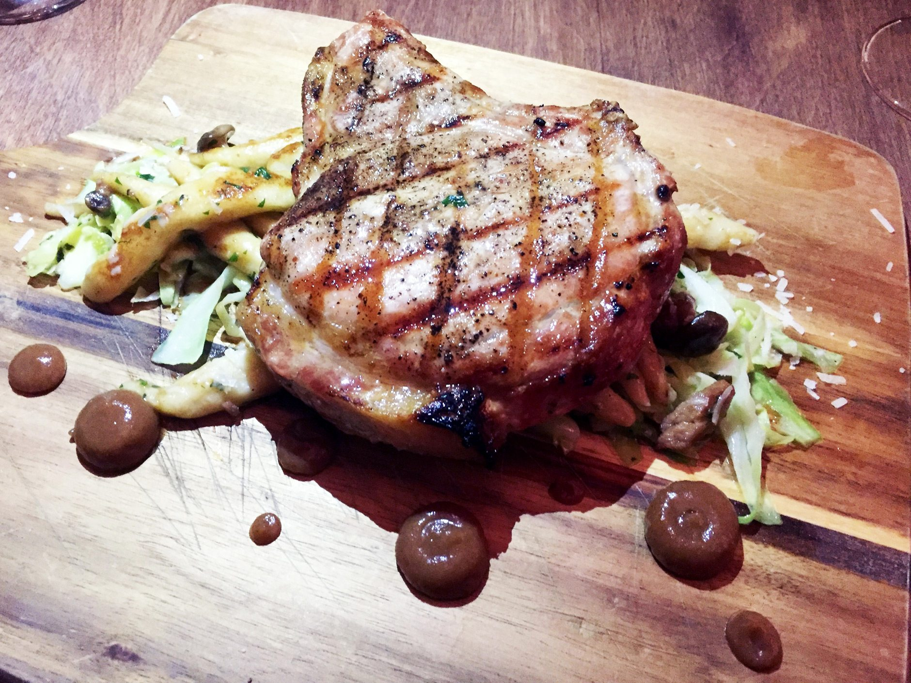 Grilled pork chop, which sat heavily on a bed of herbed schnupfnudel, with beech mushrooms and lightly sautéed cabbage