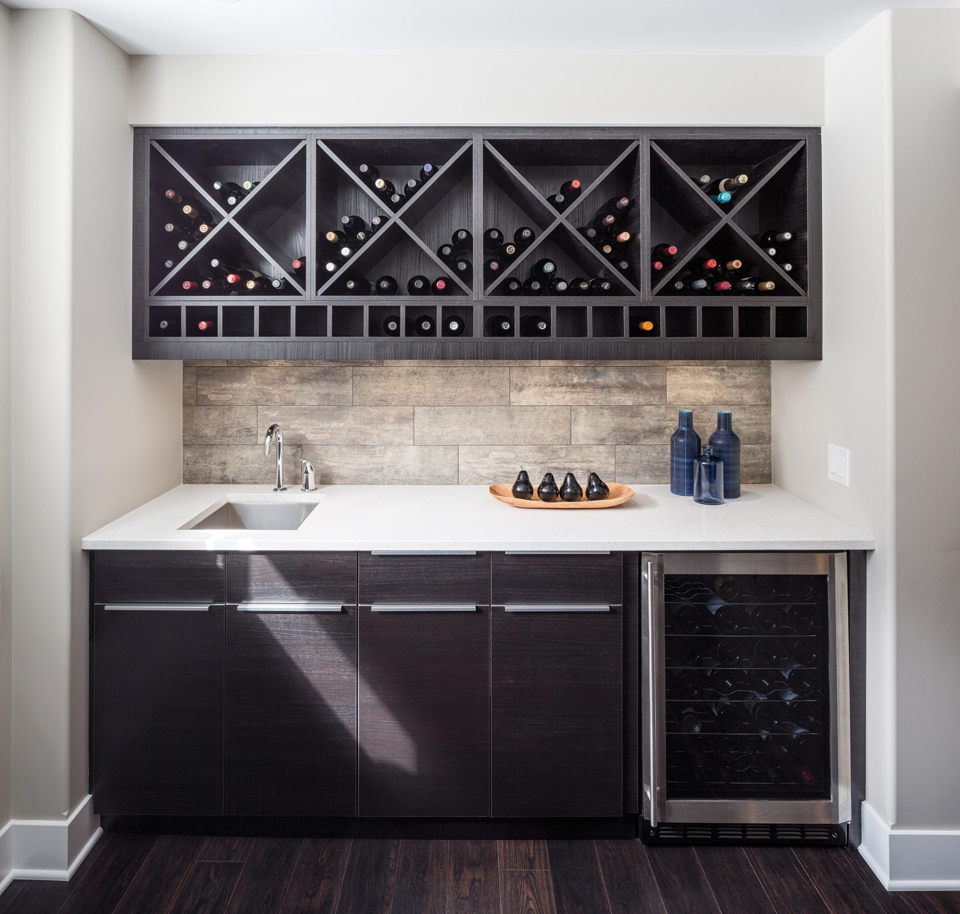 The wine fridge holds up to 30 bottles. The bar area and the decorative wine wall offer space for an additional 150 bottles. Lecuyer notes that his clients are wine appreciators rather than serious collectors so were not concerned about storing their collection in a strict climate-controlled environment. Photo: Justin Van Leeuwen