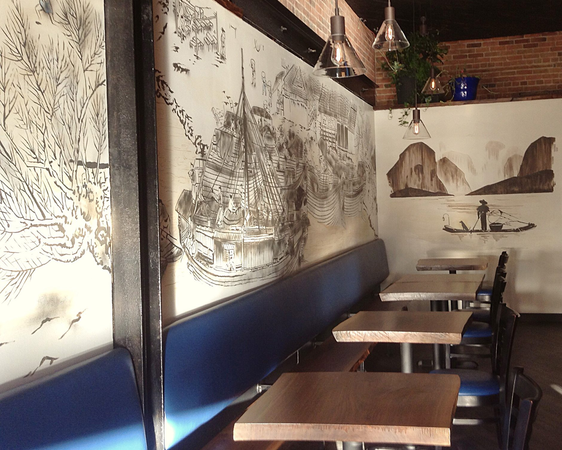Local artist Dan Metcalfe painted the wall mural, based on a Chinese scroll Elliott and Caroline showed him
