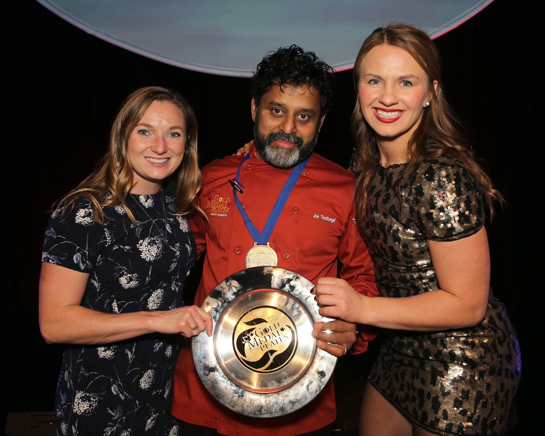 Joe Thottungal poses with Olympians Rosie MacLennan and Erica Wiebe