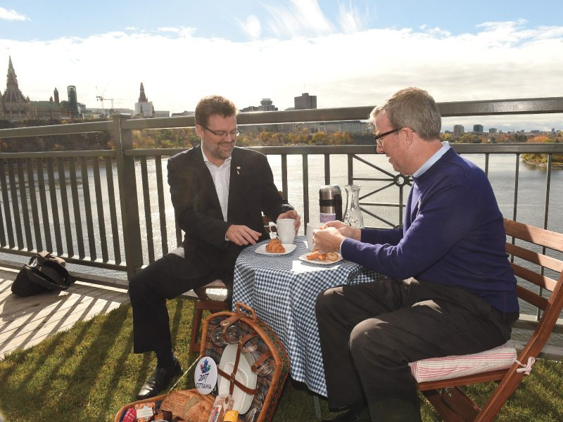 Gatineau's mayor, Maxime Pedneaud-Jobin, shares a picnic with Ottawa mayor, Jim Watson, in advance of the Interprovincial Picnic on the Bridge, scheduled for July 2, 2017
