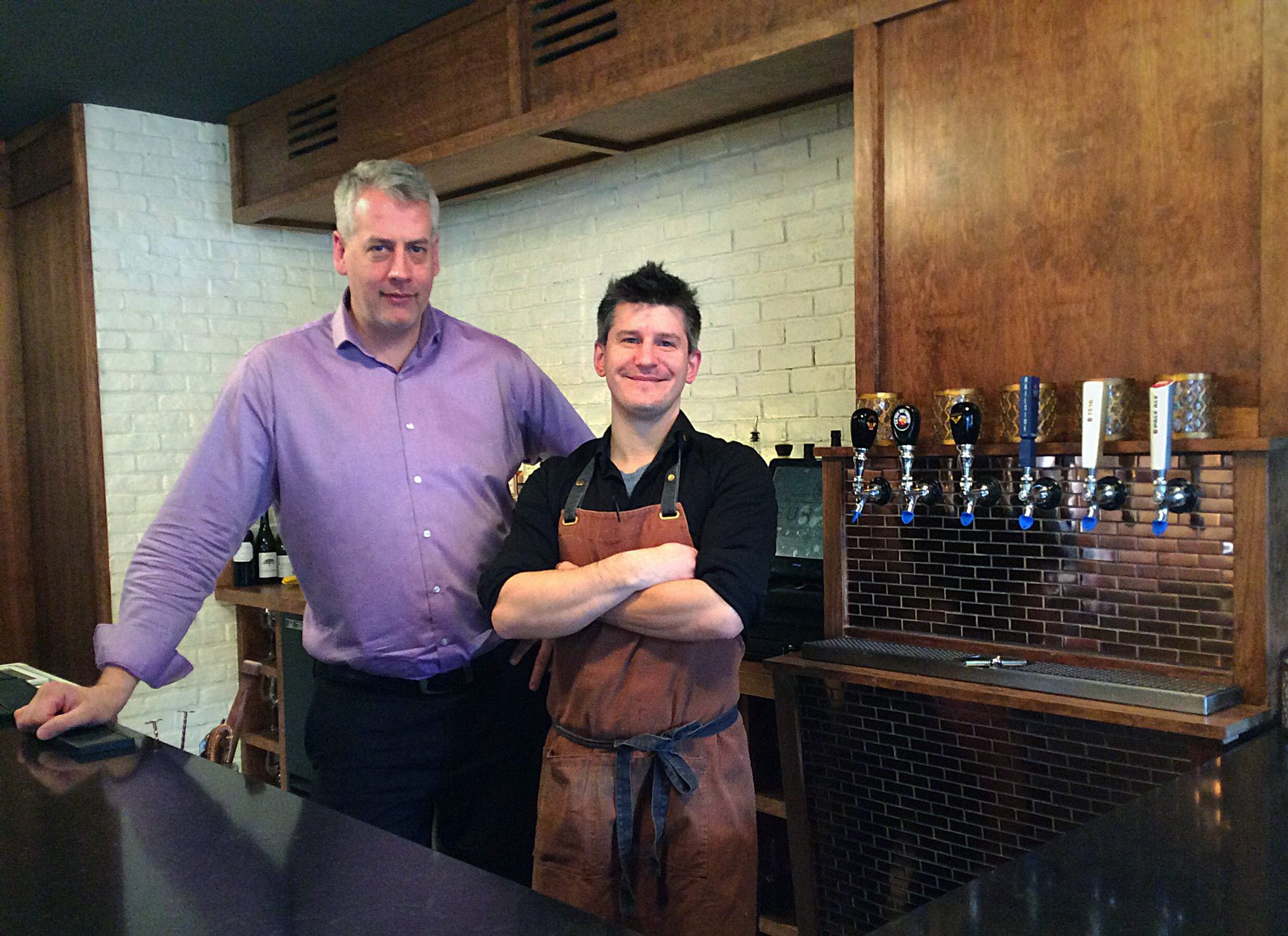 Sur-Lie owner Neil Gowe (left) and chef Nick Berolo at ease behind the L-shaped bar