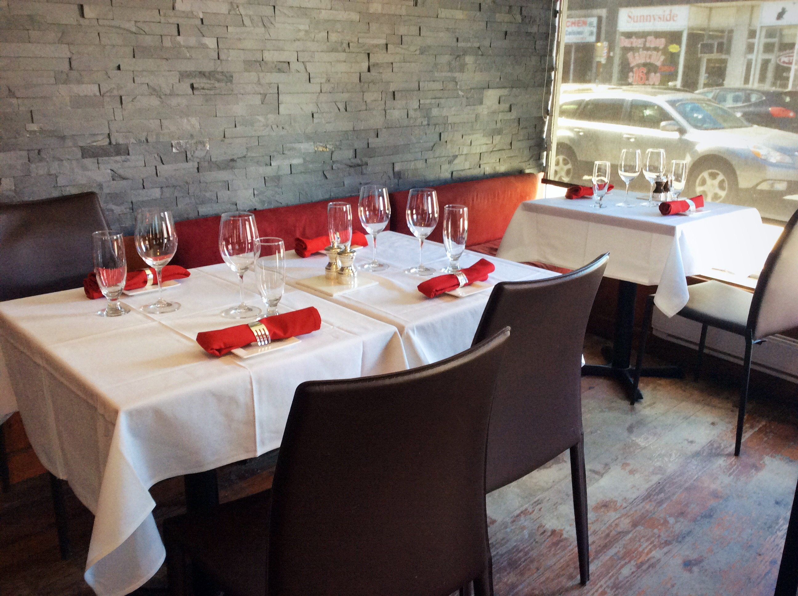 A quick refresh of the restaurant has made the space much brighter, with white, red, and grey as the dominant colours
