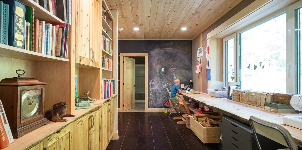 Crafted by local builder Ben Chicoine, the main house embraces new technologies with rustic beauty — beautifully patterned rammed-earth walls, reclaimed wood, and triple-glazed windows