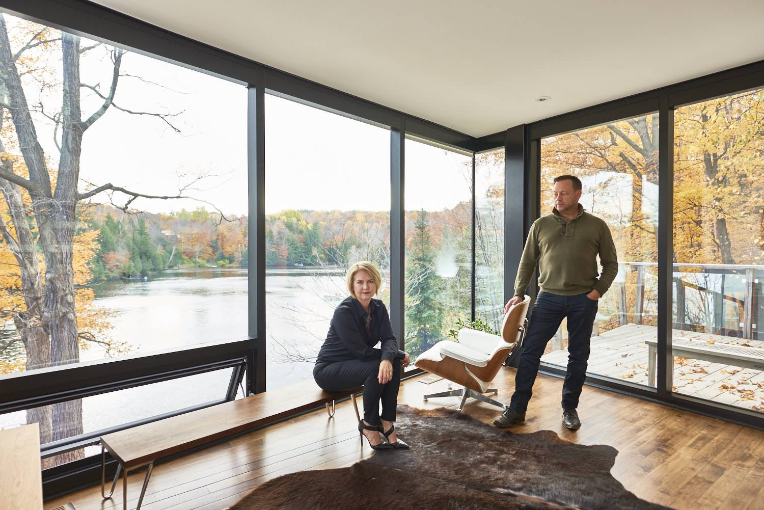 Owner Gordon McMillan with Marie-Claude Faubert, whose company, Faubert Interiors, oversaw the renovation. One of the designer's recommendations was adding floor-to-ceiling windows in rooms with spectacular views of the river. Photography PhotoluxStudio.com — Christian Lalonde