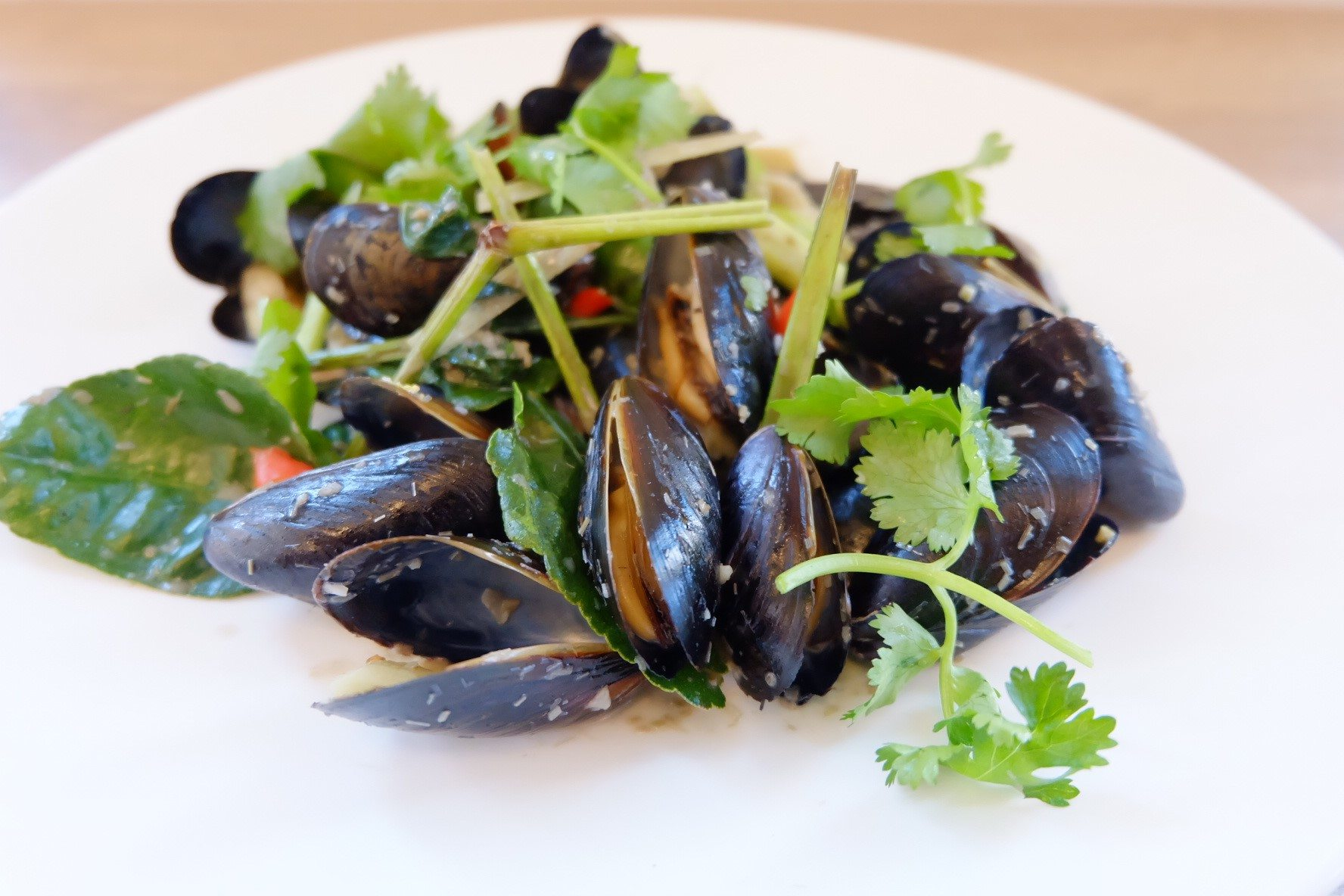 Coconut Mussels from Sen Asian Cuisine sees Canadian mussels fused with a delicious Vietnamese snail recipe, coconut milk, lemongrass, Asian herbs, and sake
