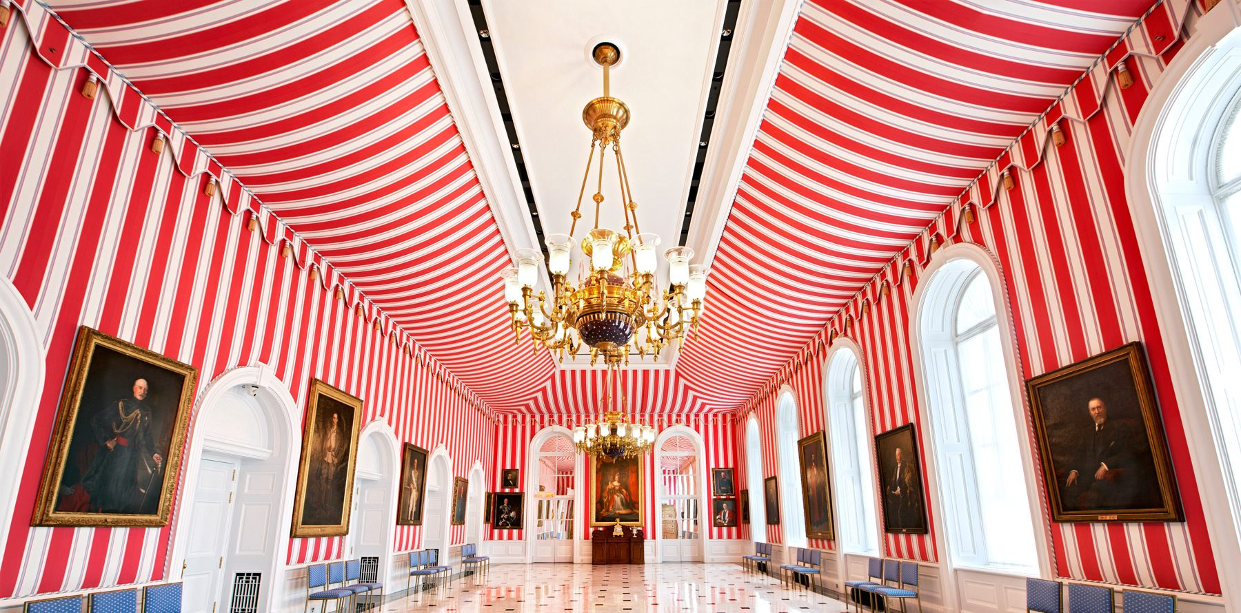 "After the government purchased the land in 1868, the former MacKay family home (built in 1838 by stonemason Thomas MacKay) was added to extensively, creating a patchwork of styles, but none so unusual as the Tent Room. Resembling a candy cane or a popcorn box, it was created by the Earl of Dufferin (Canada's third governor general) to host indoor parties reminiscent of outdoor events held in England's more accommodating weather. The room also doubled as a tennis court. Later, portraits of key figures in Canada's sports history replaced tennis racquets and balls: Lord Stanley, who donated ""the cup,"" and Earl Grey, who donated the other (CFL) ""cup."" Elsewhere, Glenn Gould's practice piano occupies a corner of the Long Gallery, while the Ballroom bedazzles guests with its one-tonne chandelier (boasting 12,000 crystals) given to Canada by England for its aid in the Second World War. Caption: Matt Harrison. Photo: Marc Fowler"