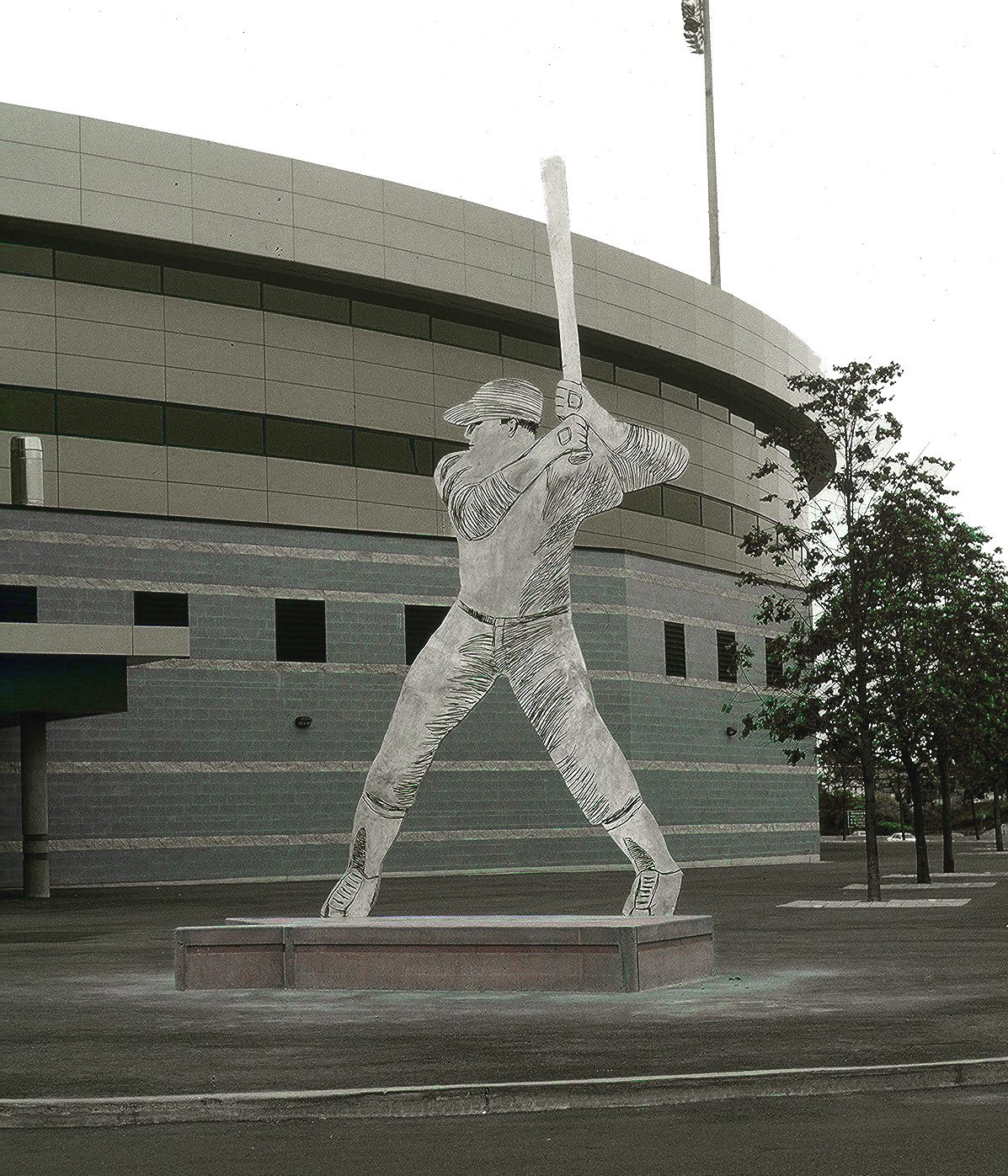 Switch Hitter, a 22-foot-high baseball player, bat raised and awaiting the pitch, is in front of the Raymond Chabot Grant Thornton stadium