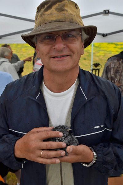 "Peter Huszcz, who has been tending the purple martin ""condo complex"" at the Nepean Sailing Club for the past 15 years, also monitors a smaller 32- cavity nesting box in his own backyard. Photo: Tony Beck"