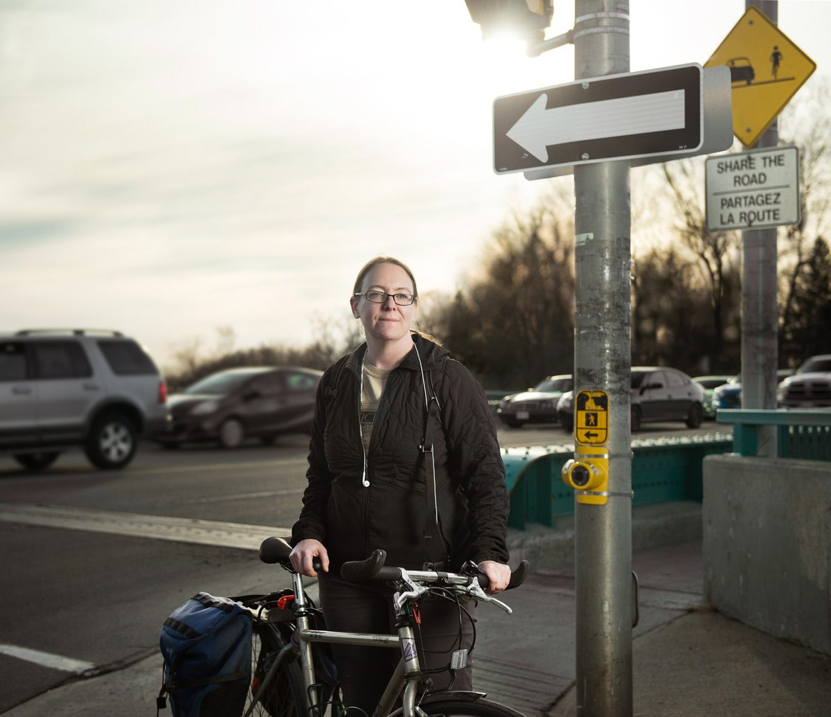 Kathryn Hunt commutes by bike from her home in Heron Gate to her job downtown, a trip that means battling cars for room on the road. Photo: Luther Caverly