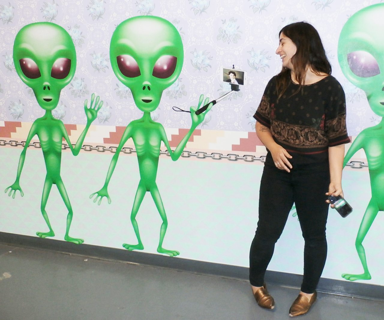 Artist Dominique Petrin of Montreal stands in front of her mural-like work UFO Canada. Photo: Paul Gessell