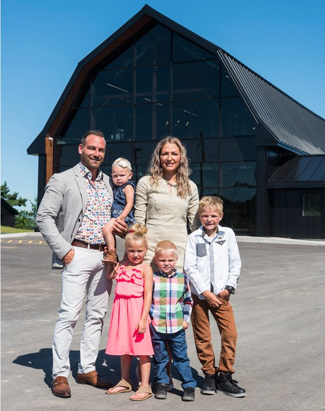 Shawn Lamarche nd Elyse Beaulieu and their four children standing outside their new offices. Photo: Dwayne Brown