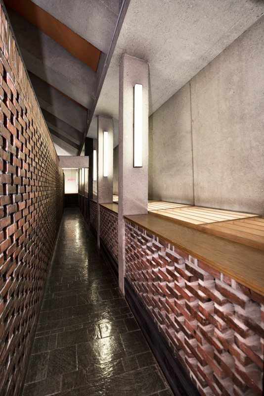 The lattice-brick pattern of the hallways leading to the sanctuary allowed nuns late to mass to arrive unnoticed. Photography: Marc Fowler