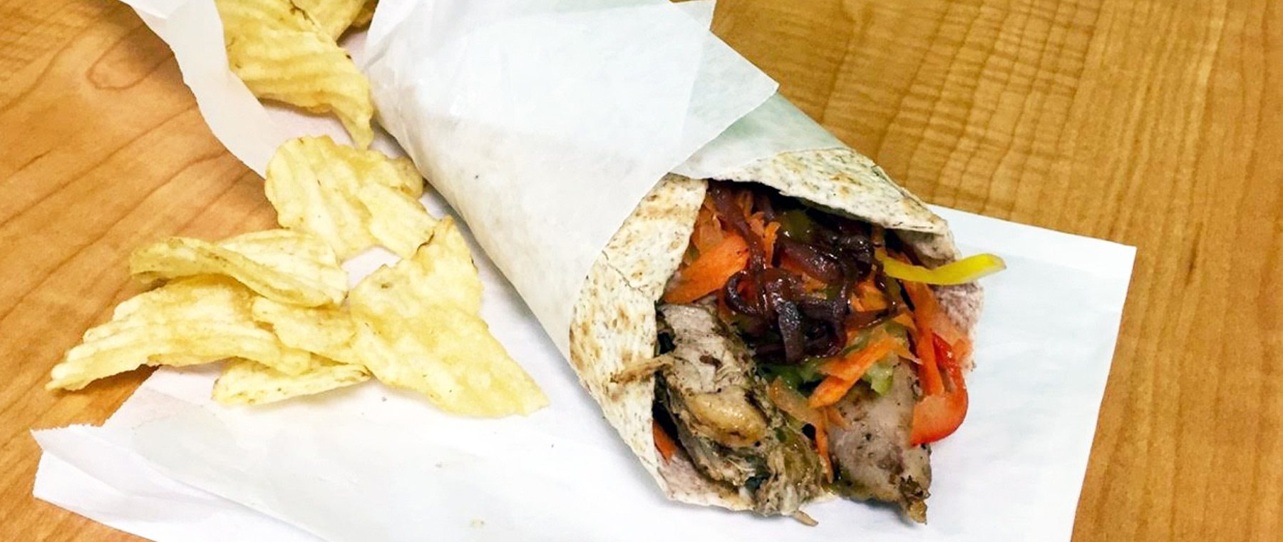 CFC's jerk chicken tucked inside the soft flour tortilla