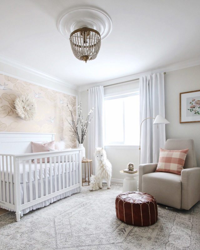 "You don't have to limit yourself to ""kid stuff"" when decorating a baby's room. Here, the crib is the only piece of furniture in the room specifically designed for children"