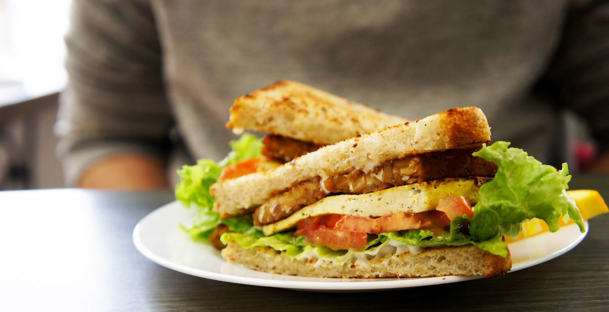 Grow Your Roots: Breakfast TLT (tofu egg, tempeh bacon, tomato, mayo and lettuce)