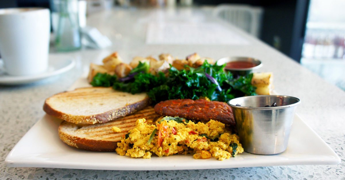 Pure Kitchen: The Standard (tofu scramble, home fries, tempeh bacon, sautéed kale, toast & jam)