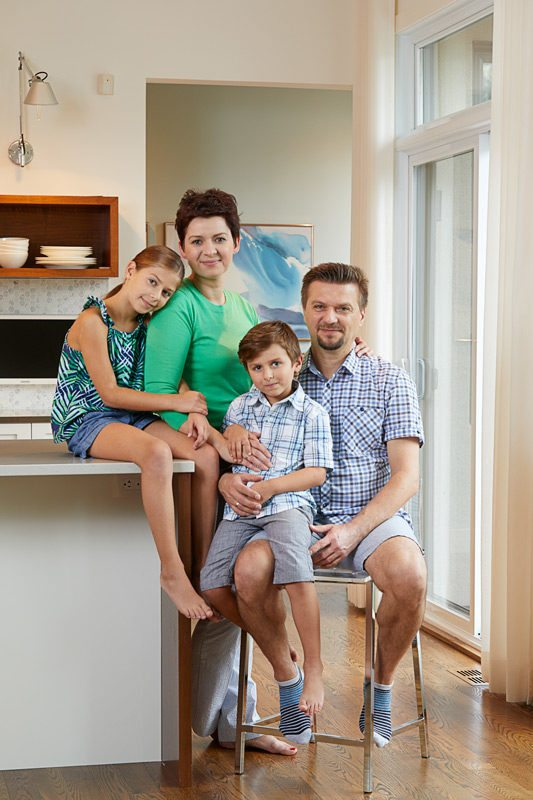 Creative and practical, Tatiana and Chris took the lead in designing a unique home in Greely. They are pictured here with their children, Maia and Marcus. Photography: Miv Fournier