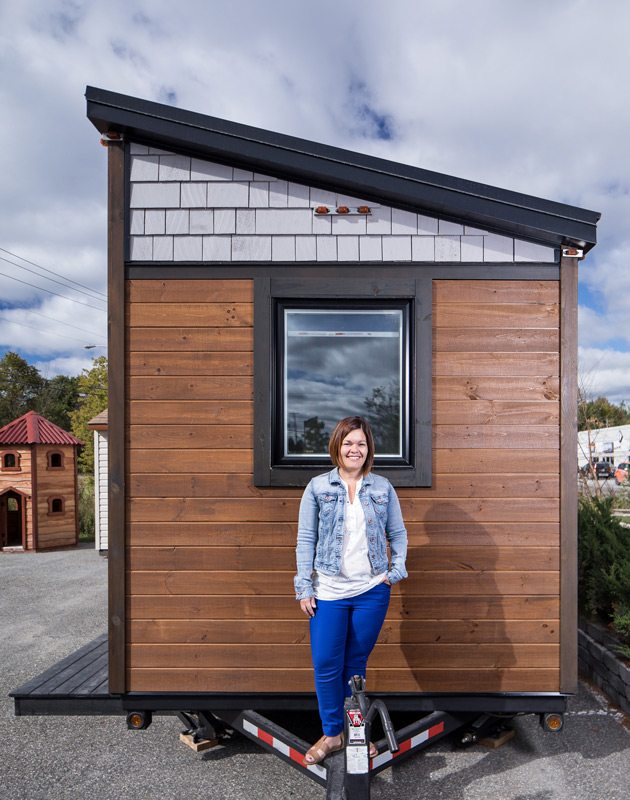 Nathalie Rodrigue, Lumbec's director general, in front of the company's display tiny house. Photo: Justin Van Leeuwen