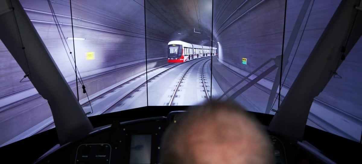 Peter Dornan seeing a virtual-reality view of an underground portion of the Confederation Line track. Photo: Remi Theriault