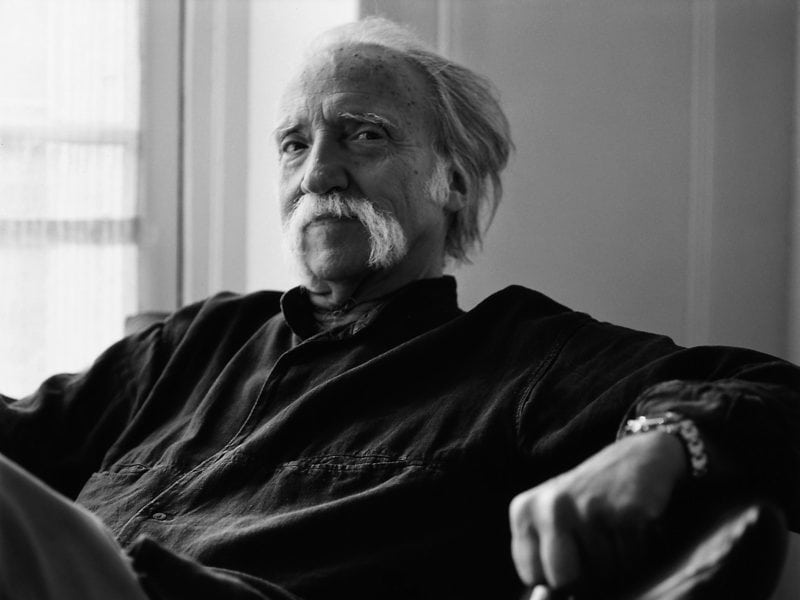 A portrait of painter-sculptor-designer Hans Hopfer, who came up with the signature sofa in 1971