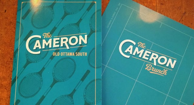 The Cameron's menu covers, which play to the tennis club theme