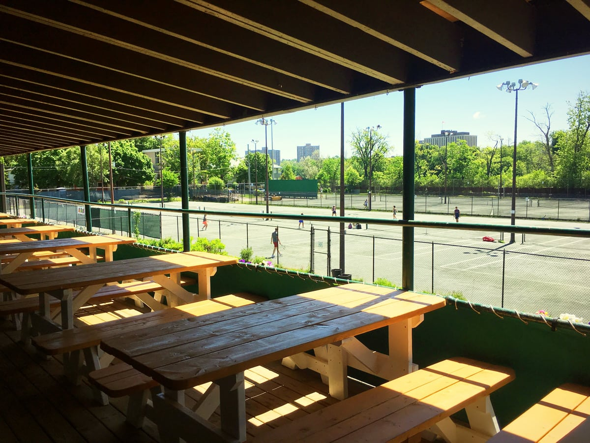 A huge second-floor patio is a great place to enjoy a cold beer or cocktail, with views over the tennis and volleyball courts