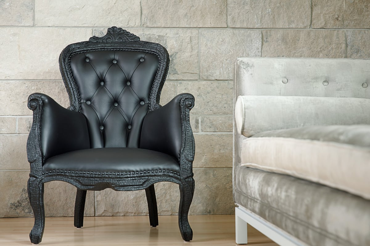 "Described by as ""furniture finished by fire,"" this Smoke series armchair was a must-have for Louise Malhotra"