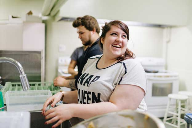 "Rachel,* 22, loved FoodWorks so much that she came back to volunteer after her six-month stint ended. ""I missed working with Bruce. He's honestly one of my favourite people"". Photo: Ben Welland"